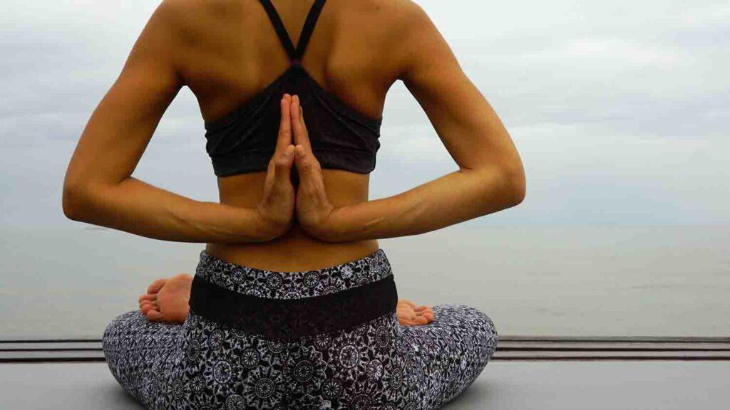 Woman is performing bikram yoga