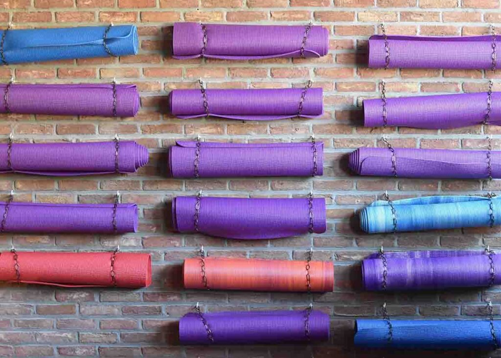 Cheap yoga mats hanging on the wall