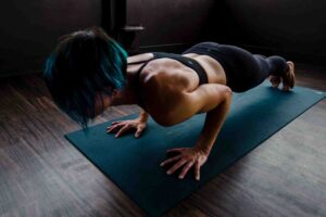 Woman is doing hot yoga on a mat