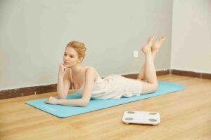 Girl doing power yoga on mat