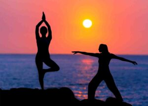 Women's are doing tai chi and yoga