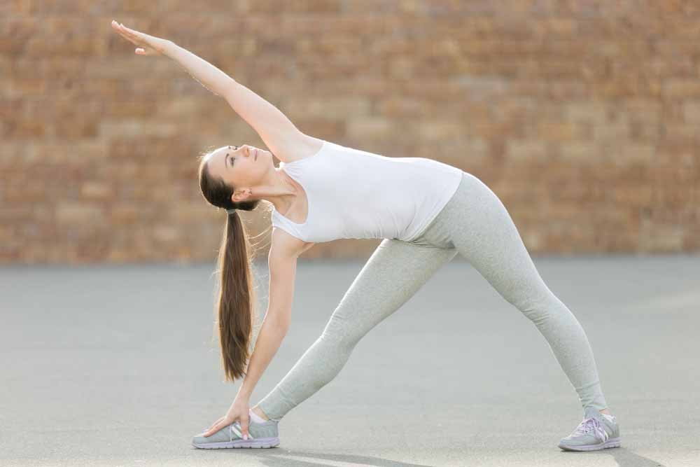 Woman performing Side stretch yoga pose