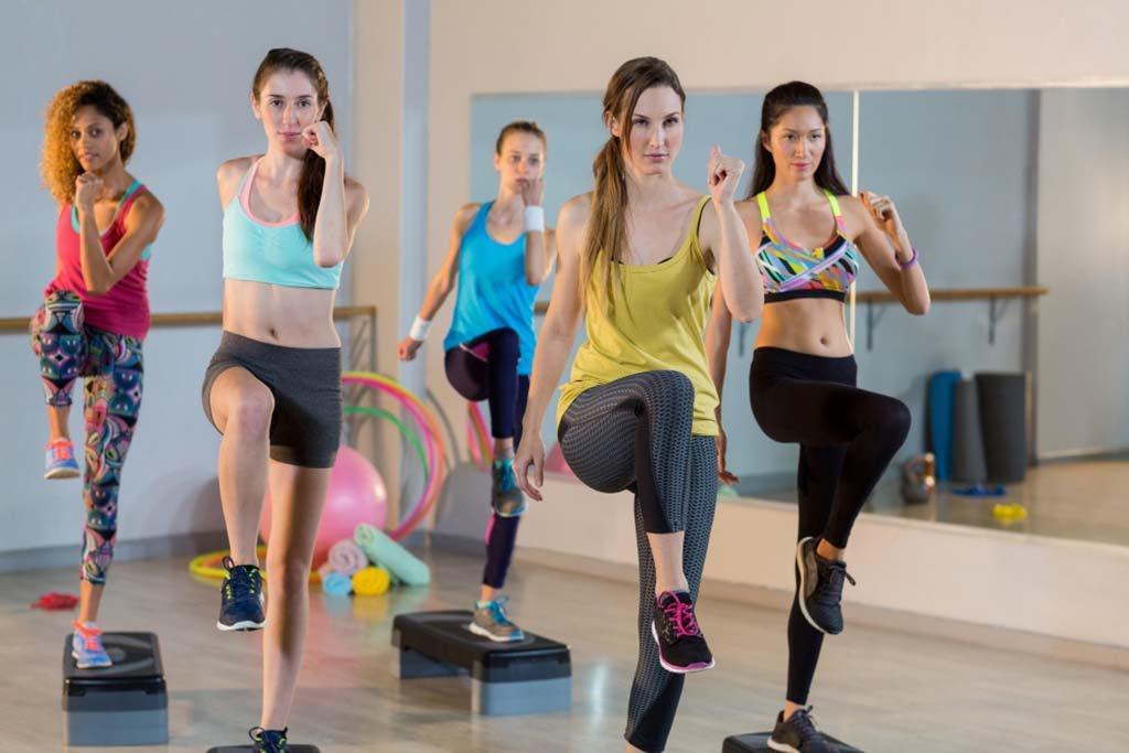 group-women-exercising-aerobic-stepper